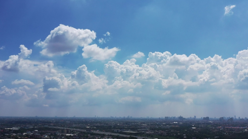 Beautiful clear blue sky with white clouds background. Time lapse clouds 4k rolling puffy cloud movie. high beautiful cloud space weather beautiful blue sky glow clouds background. Royalty-Free Stock Footage #1039034876