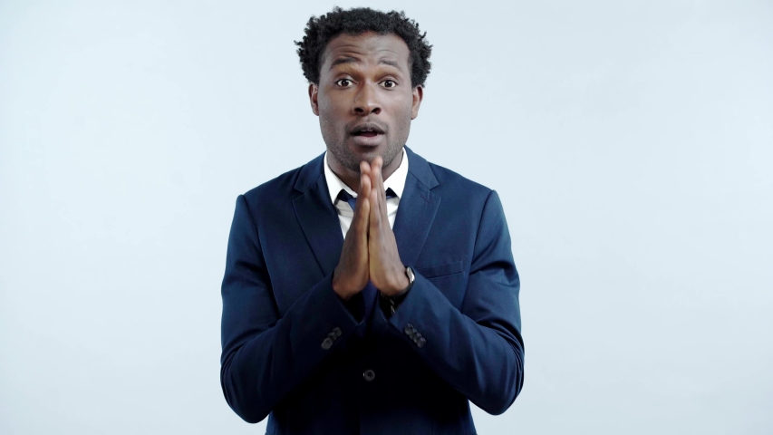 African american businessman showing praying gesture isolated on grey | Shutterstock HD Video #1039039481