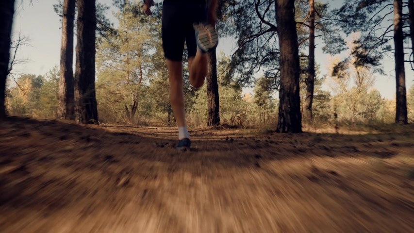 Marathon Runner Jog On Forest.Running Man Sport Workout.Triathlete Running,Sprinting And Endurance Workout Training.Runner Man Fit Athlete Legs Jogging On Trail For Triathlon.Sport Recreation Concept. Royalty-Free Stock Footage #1039057205