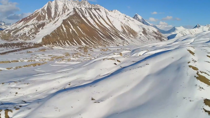 Mountain range Zagros. Mountain systems of Iran. Snow covered mountains in central Iran, near Yazd (aerial photography) | Shutterstock HD Video #1039070552