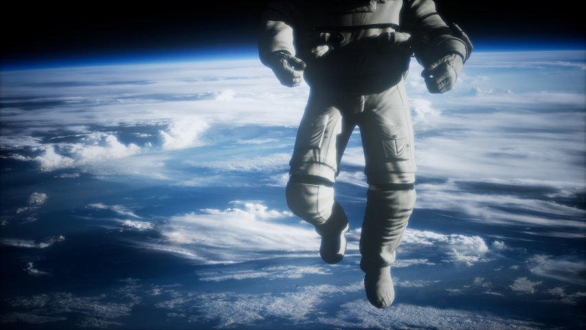 Astronaut in outer space against the backdrop of the planet earth. Elements of this image furnished by NASA. | Shutterstock HD Video #1039079189