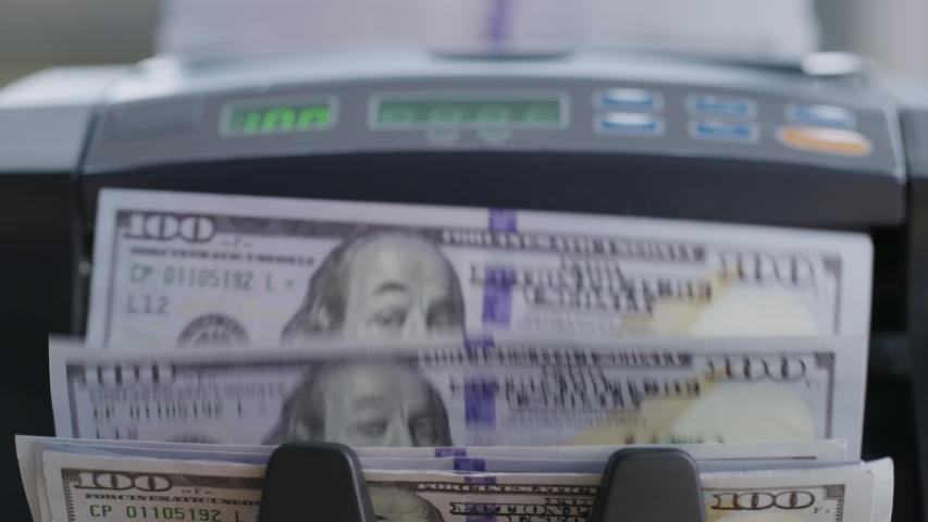 Closeup shot of money counting machine with 100 dollar bills. | Shutterstock HD Video #1039111496