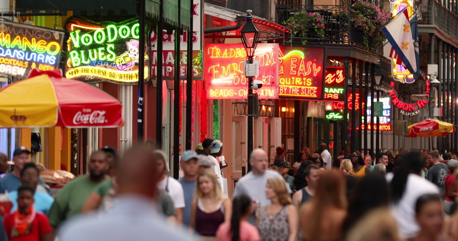 New Orleans, Louisiana - June 16, 2019: Crowds of people party and walk along the French Quarter bars and restaurants on Bourbon Street New Orleans Louisiana USA