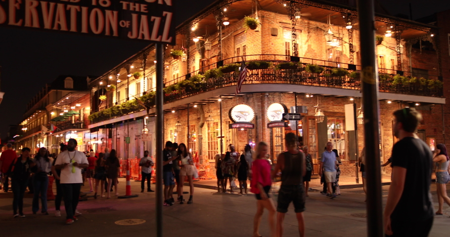 New Orleans, Louisiana - June 16, 2019: Crowds of people party and walk by the famous Preservation Hall Jazz Bar in the French Quarter bars and restaurants on Bourbon Street New Orleans Louisiana