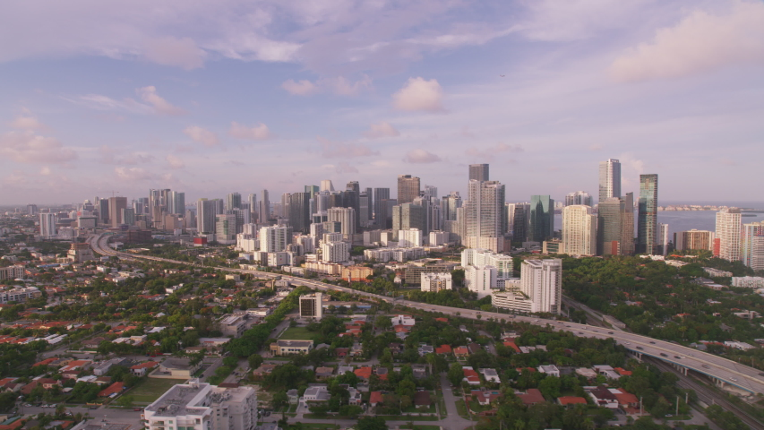 Miami, Florida circa-2019. Aerial view of Miami at sunset. Shot from helicopter with Cineflex gimbal and RED 8K camera. | Shutterstock HD Video #1039113365