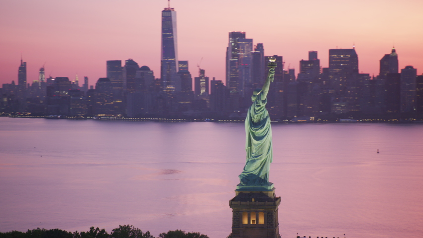 New York City, New York circa-2019. Aerial view of Statue of Liberty at sunrise. Shot from helicopter with Cineflex gimbal and RED 8K camera.