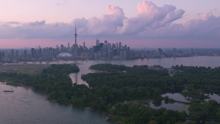 Toronto, Canada circa-2019. Aerial view of Toronto at sunset. Shot from helicopter with Cineflex gimbal and RED 8K camera. | Shutterstock HD Video #1039114547