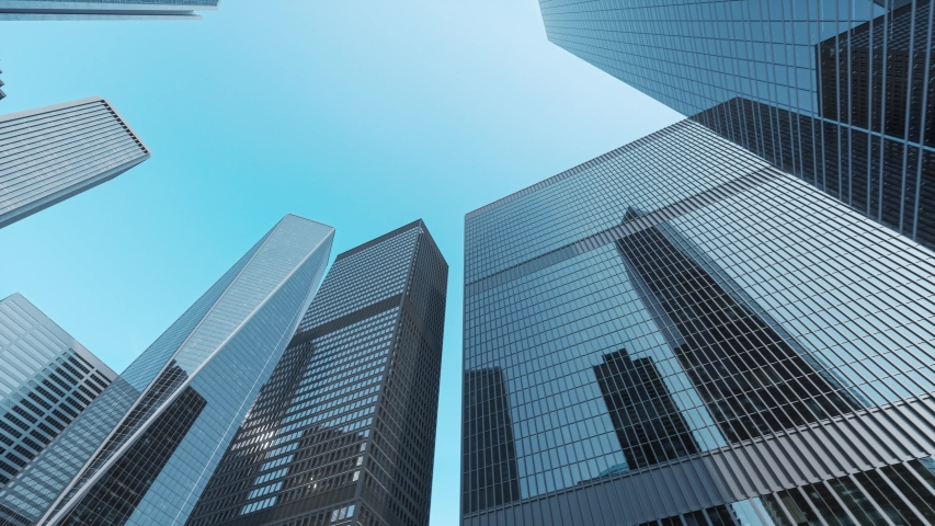 Modern office high rise skyscraper buildings. City business district. Looking up at business buildings. Low angle view of business buildings Royalty-Free Stock Footage #1039121558