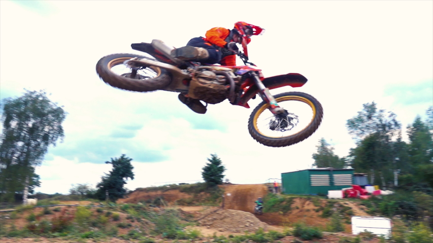 Extreme Motocross MX Rider riding on dirt track   Shutterstock HD Video #1039130819