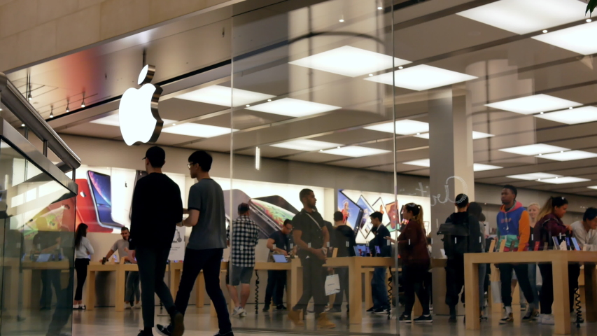 Burnaby , British Columbia / Canada - 09 11 2019: Burnaby, BC, Canada - September 11, 2019 : Motion of people playing new iphone inside Apple store with 4k resolution.