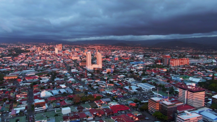 Beautiful cinematic aerial view of the sunset in the city of San Jose Costa Rica