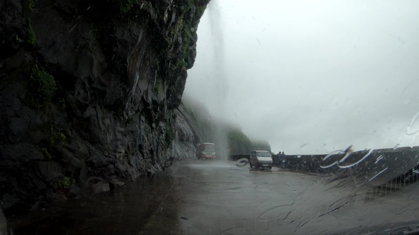 Water falling on Car while travelling #1039150607