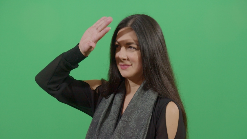 Woman manipulation the hand as a shade studio isolated shot against green screen scene | Shutterstock HD Video #1039150982