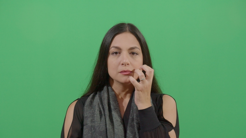 Trauma demonstrated by an female studio isolated shot against green screen background | Shutterstock HD Video #1039151003