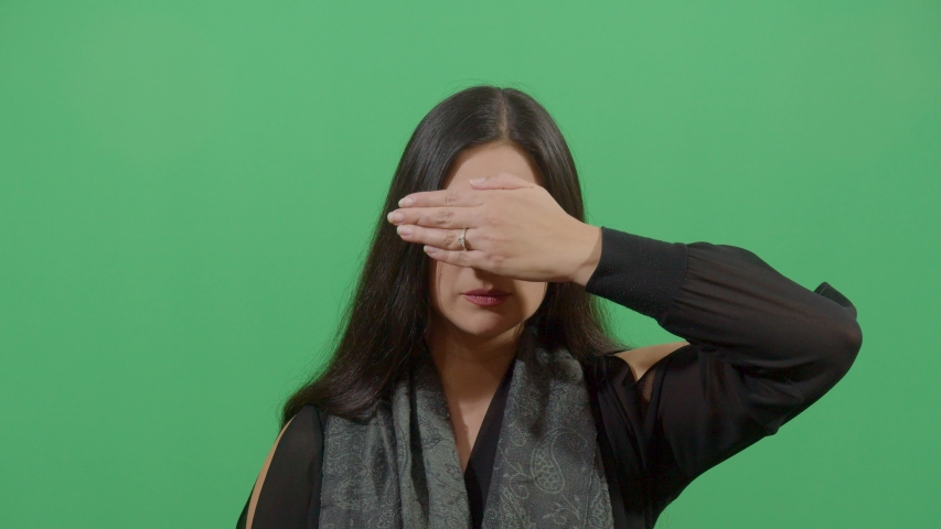 Human making a posture with her nails like i do not want towards vision studio isolated shot versus green screen background | Shutterstock HD Video #1039151006