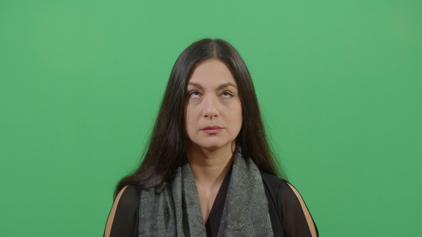 Up and down eyes movement of a woman like reading very fast or chasing an object studio isolated shot against green screen background | Shutterstock HD Video #1039151009