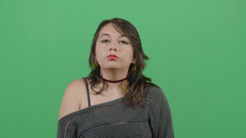 Lady display both sides of the facial studio isolated shot opposite green screen background | Shutterstock HD Video #1039151231