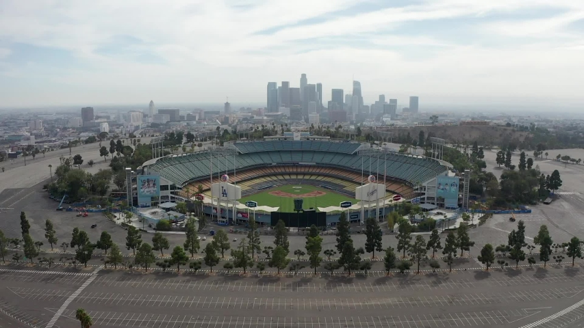 Los Angeles / United States - 09 21 2019: Dodger Stadium, home of Los Angeles Dodgers, with city background, aerial view