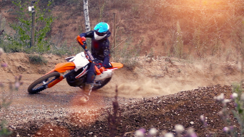 Extreme Motocross MX Rider riding on dirt track on a sunny late summer day on public training session in preparation for Motocross event - slow motion shot   Shutterstock HD Video #1039181705