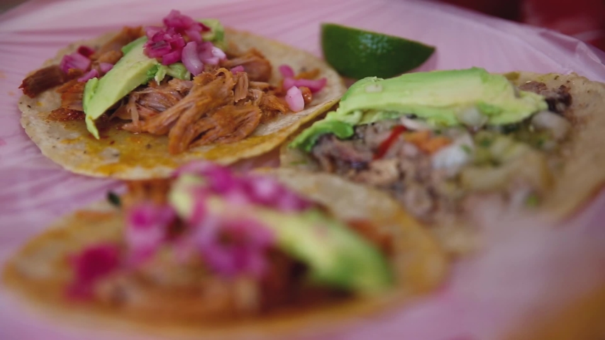 Traditional Mexican tacos are filled with sauce
