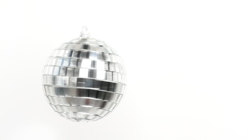 Disco Mirror Ball Spinning on white background | Shutterstock HD Video #1039242881