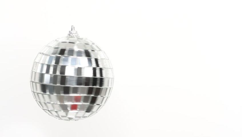 Disco Mirror Ball Spinning on white background | Shutterstock HD Video #1039242890
