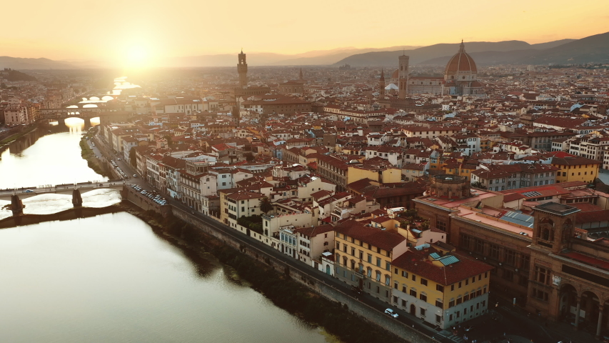Aerial Drone View: Historically and Culturally Rich Italian Town on the Sunny Day. Beautiful Old City With Medieval Churches and Cathedrals. River Runs through the City Royalty-Free Stock Footage #1039245227