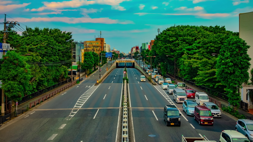 A timelapse of downtown street at the avenue wide shot tilt. Setagaya district Tokyo Japan - 08.24.2019 : It is a center of the city in tokyo. | Shutterstock HD Video #1039281224