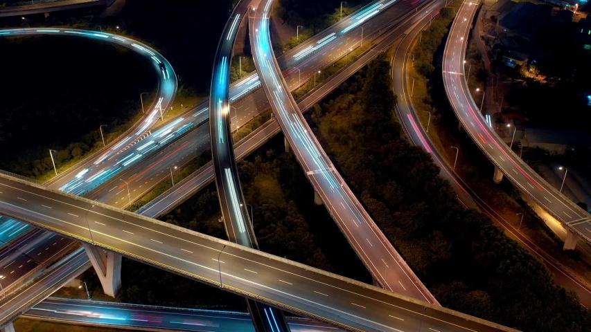 Hyperlapse timelapse of highway interchange - Transport concept footage, birds eye view use the drone at night in Taoyuan international airport system interchange, Taoyuan, Taiwan. | Shutterstock HD Video #1039285607