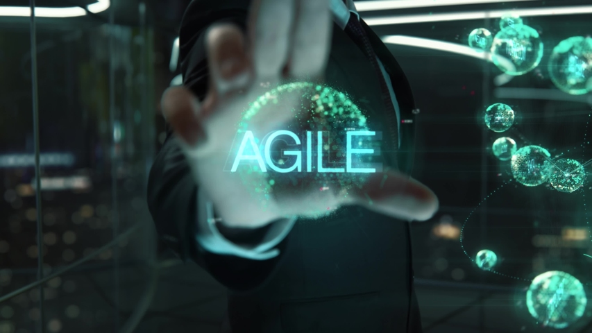 Businessman with Agile hologram concept Royalty-Free Stock Footage #1039291457