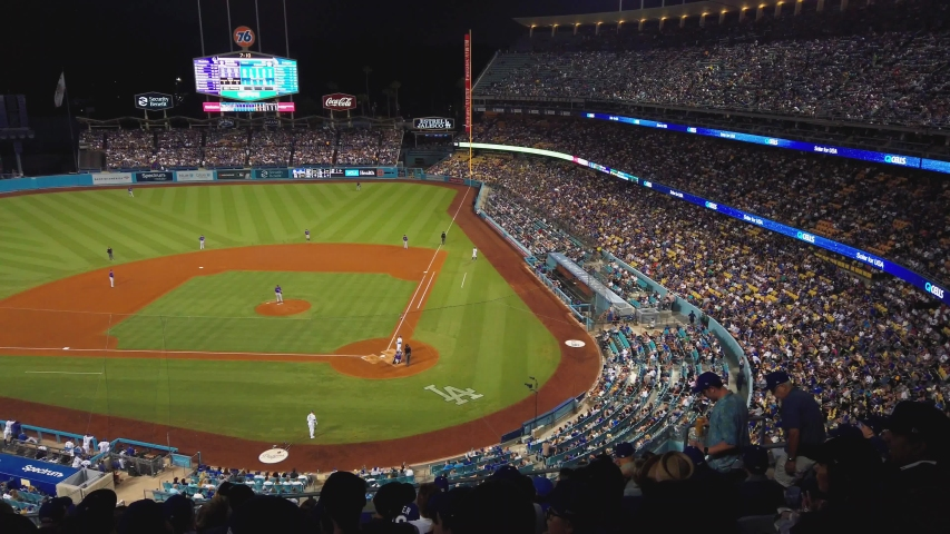 Los Angeles , California / United States - 09 29 2019: Dodgers baseball Stadium in Los Angeles California. Panning shot across stands with fans overlooking diamond.