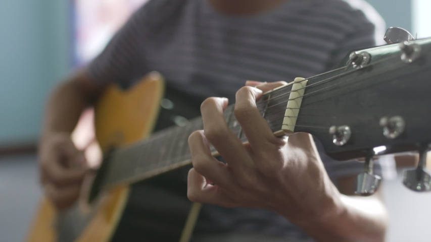 phnom penh , kandal / Cambodia - 06 02 2017: Close up of man playing guitar