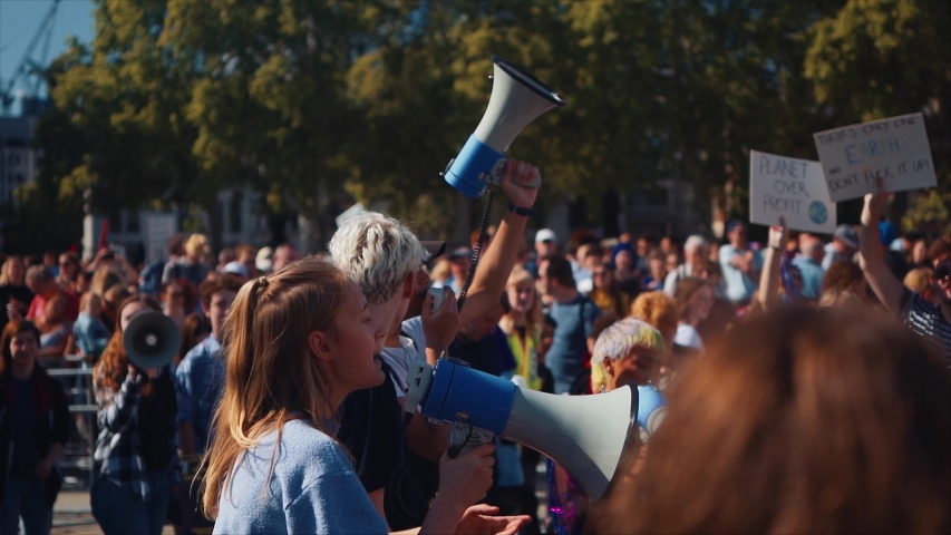 London / United Kingdom (UK) - 09 20 2019: Young girl shouts through a megaphone at a protest
