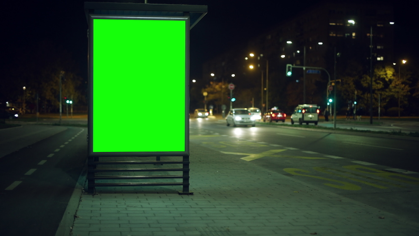 Bus stop advertising billboard green screen on city streets at night | Shutterstock HD Video #1039325057