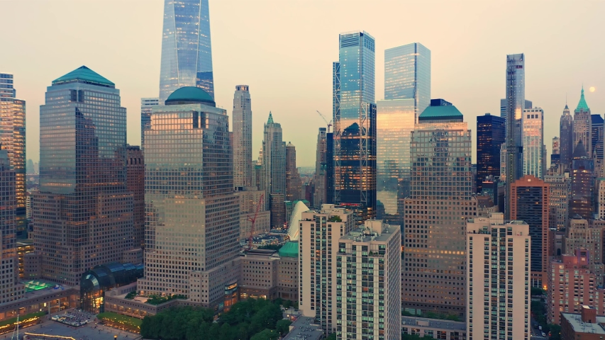 Drone footage with slow pull back away from New York City Lower Manhattan skyscrapers at dusk | Shutterstock HD Video #1039332788