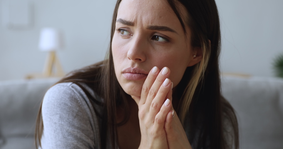 Sad worried young woman attractive face having psychological problem feeling anxiety depression, upset frustrated lonely lady thinking of grief troubled with unwanted pregnancy concept, close up view