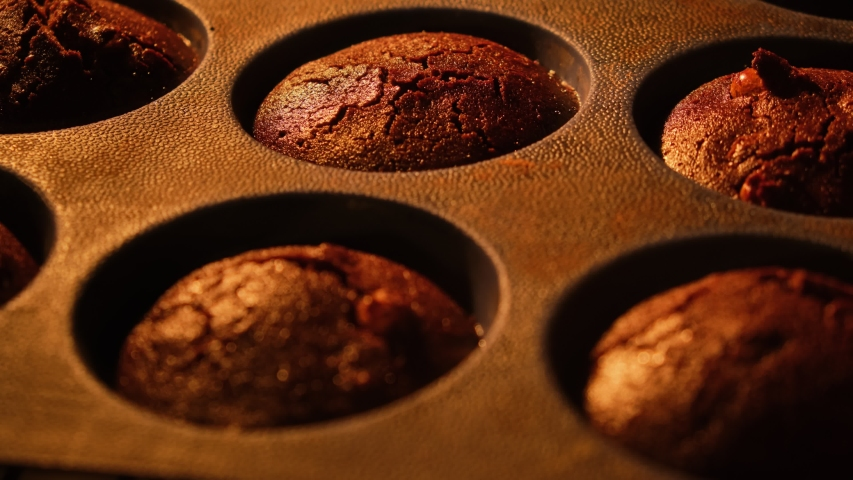 Muffins. Baking in oven. Time lapse footage of cooking Cupcakes, 4k, UHD. Cupcake. Growing muffins in oven