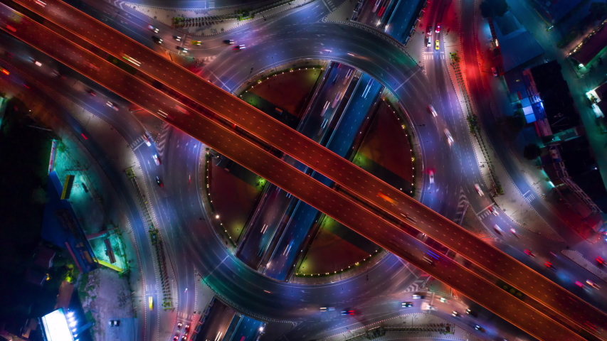 Highway intersection circle timelapse with aerial top-down view. #1039344776