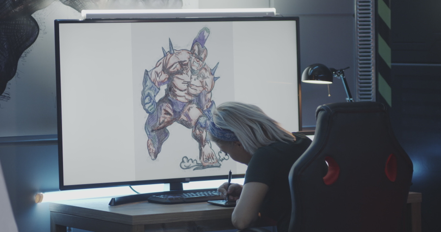 Medium shot of a young woman drawing game art on computer   Shutterstock HD Video #1039344941