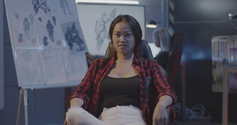 Medium shot of a female video game developer looking at camera | Shutterstock HD Video #1039345082