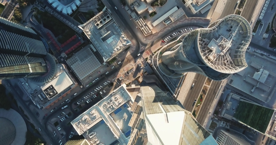 Down-looking aerial view of a global futuristic city, with skyscrapers, high rise towers and big avenues, circulation and cars, in Doha, the capital city of Qatar Royalty-Free Stock Footage #1039363835