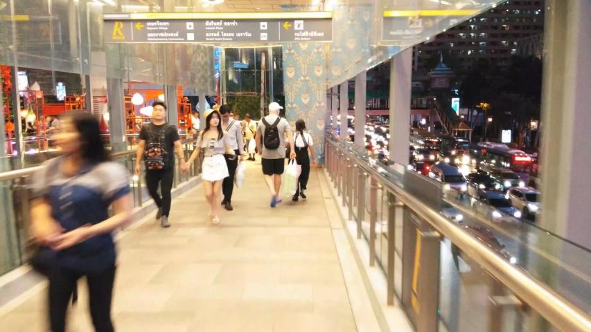 BANGKOK THAILAND -OCTOBER 4,2019 :Hyper lapse of People walking on the sky walk in Bangkok , Thailand #1039372712