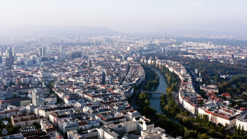 Vienna aerial view in Austria is one of the most famous capital cities of Europe. Flying by above Danube River, the historic city centre feat. old buildings around the downtown in HD and 4K | Shutterstock HD Video #1039378454