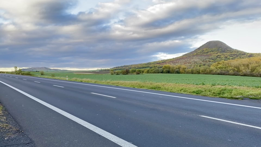 On the empty road in Central Bohemian Uplands, Czech Republic. Central Bohemian Uplands  is a mountain range located in northern Bohemia. The range is about 80 km long | Shutterstock HD Video #1039389818