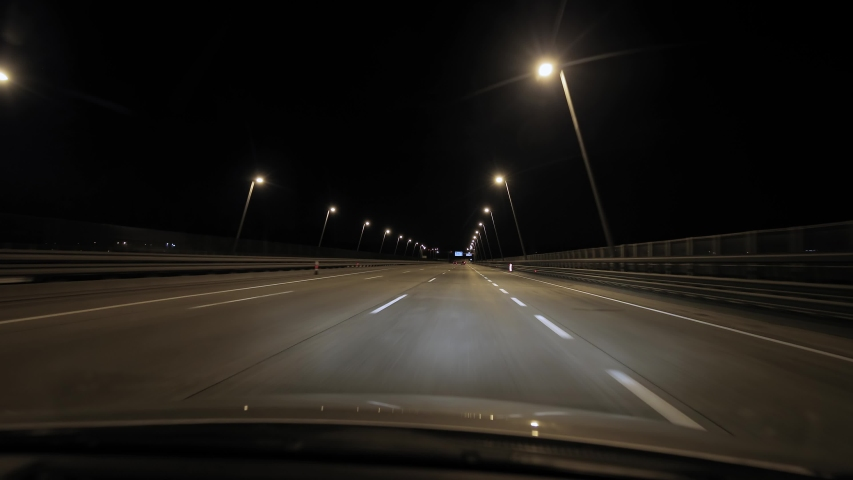 Driving on empty highway at night. M0 ring around Budapest | Shutterstock HD Video #1039396901