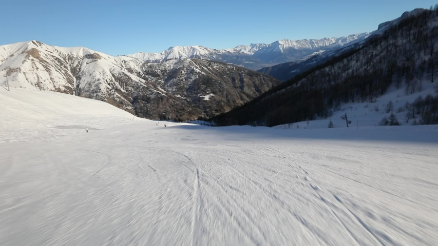 Skiing fast downhill first person point of view in the snowy mountain landscape | Shutterstock HD Video #1039401497