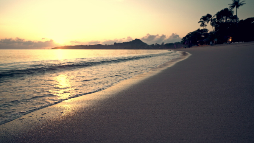 Sea surf on a sandy tropical beach at sunrise | Shutterstock HD Video #1039402301
