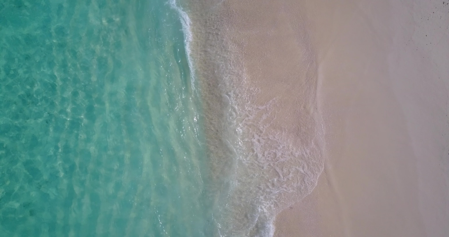 Tropical beach with turquoise ocean water and waves, aerial view of Pulau Semakau beach, Singapore | Shutterstock HD Video #1039402472