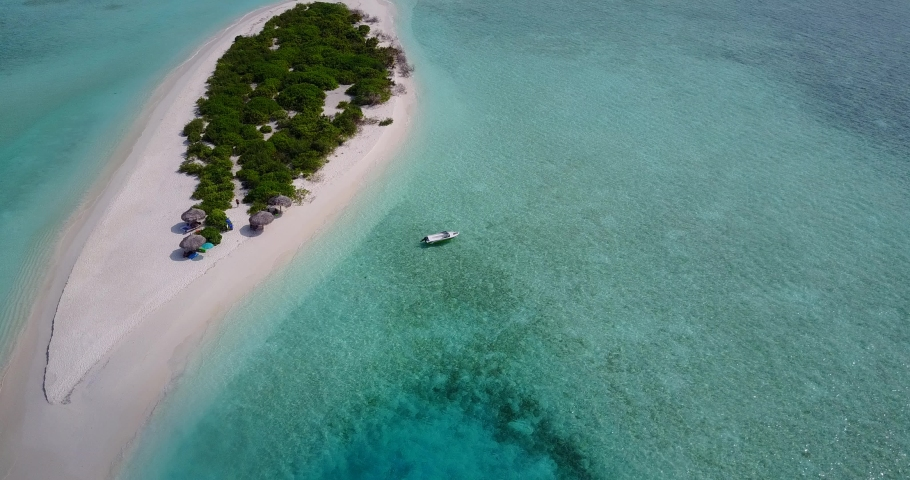 Aerial top view over a paradise tropical island with white sandy beach and beach umbrellas in Bonaparte Archipelago #1039403426