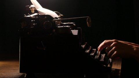 Typing on a vintage retro typewriter